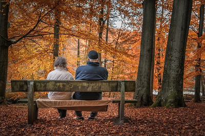 Couple sitting on a bench in Autumn