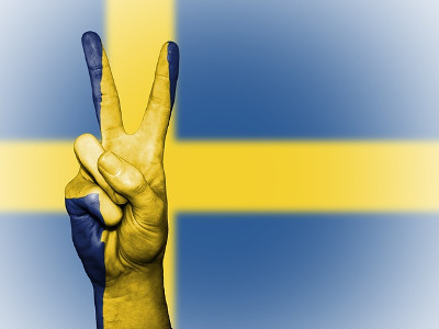 Sweden flag and victory sign